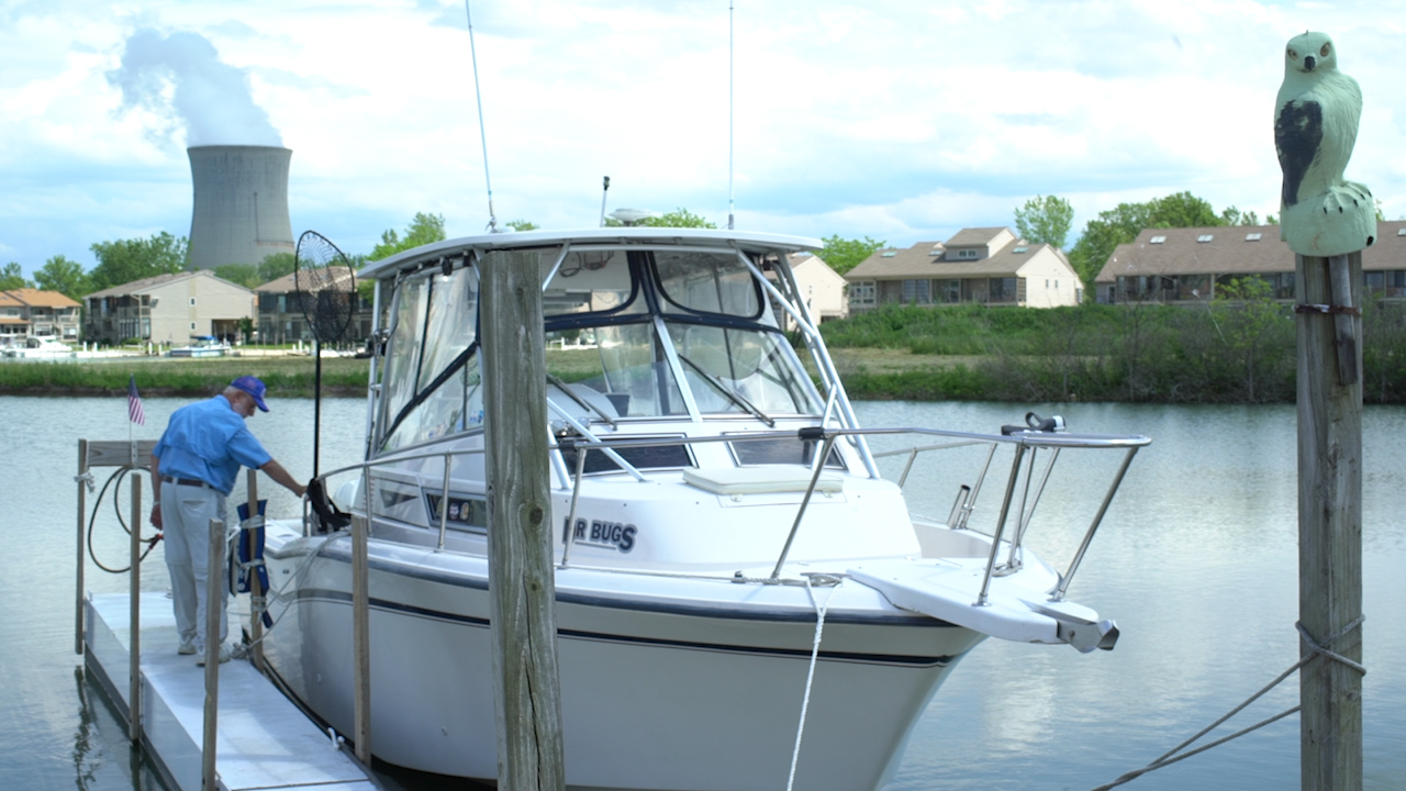Lake Erie Charter Captain Dave Spangler, sanitizing his boat between clients. Photo by Great Lakes Now.