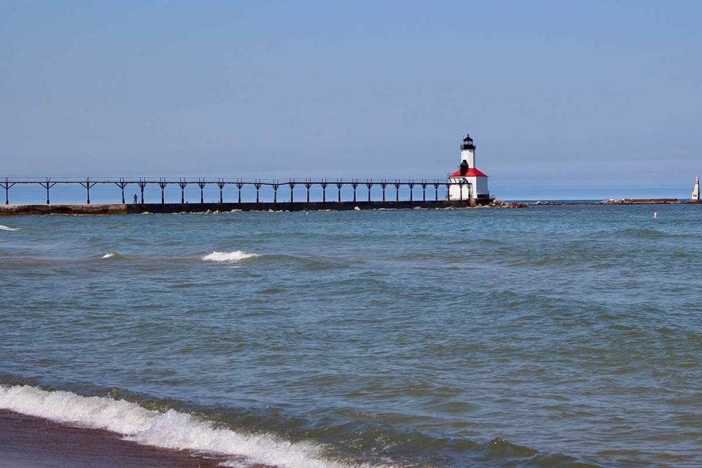 Strong and sometimes dangerous currents can form near structures along the Great Lakes, like around this Lake Michigan lighthouse along the shores of Michigan City, Ind. (Bridge photo by Jim Malewitz)