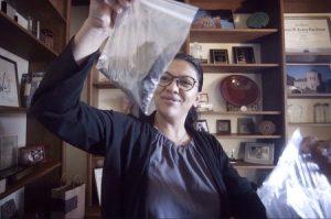 Former Michigan State Representative Rashida Tlaib with her petcoke samples in ziplock bags Bill Kubota