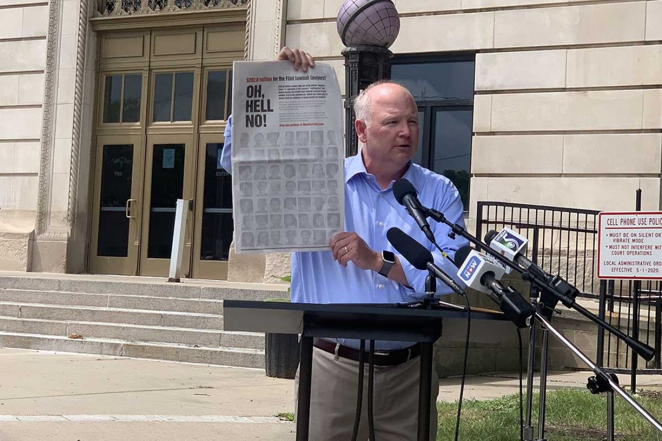 Critic protests in front of courthouse