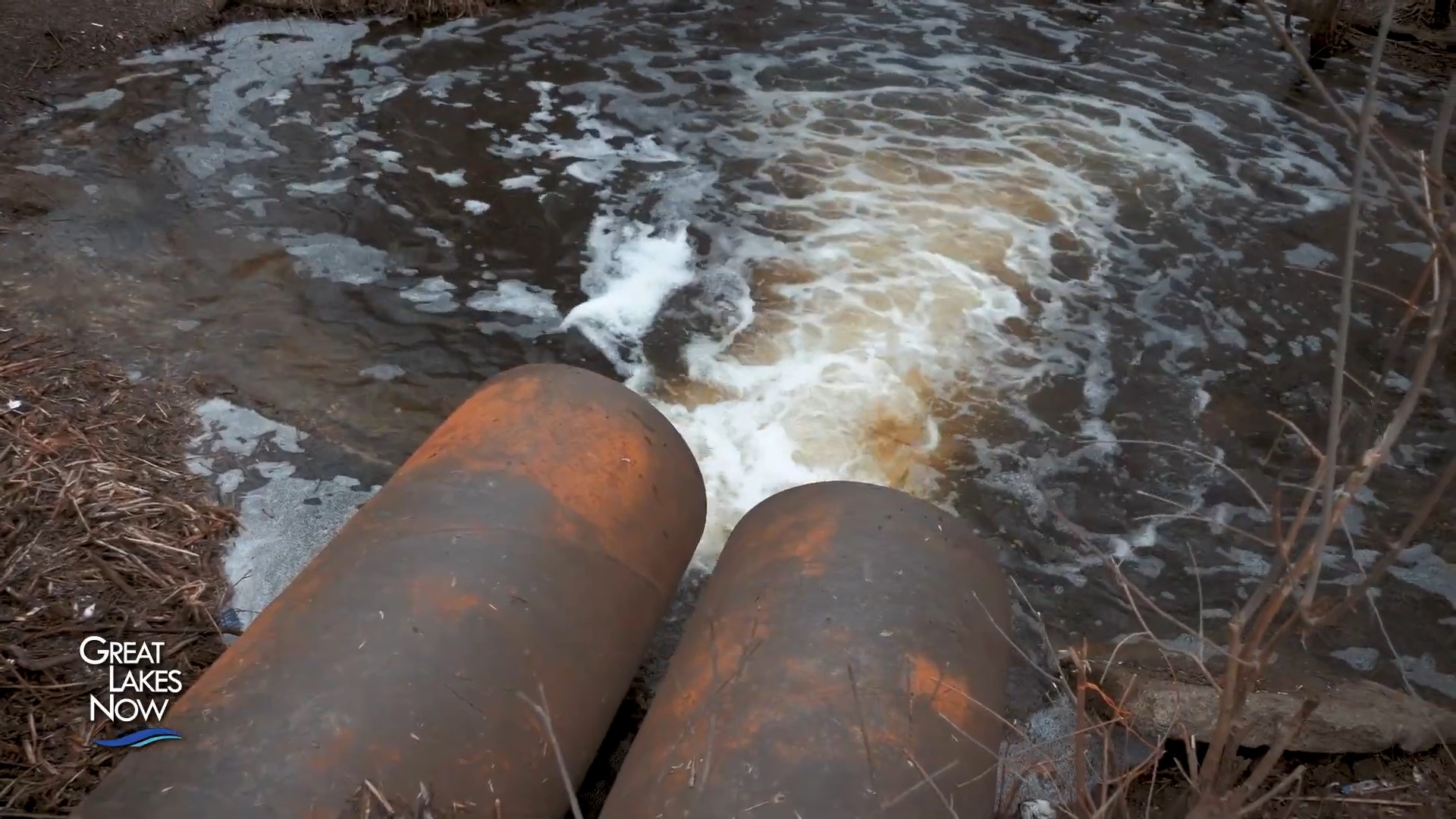 Sewer pipes releasing into a waterway